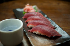 Japanese Cuisine Tuna Sushi and sake Stock Photography