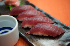 Japanese Cuisine Tuna Sushi and sake Royalty Free Stock Photos