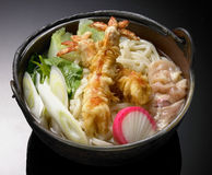 Japanese cuisine, Udon. Noodles with shrimp tempura Royalty Free Stock Photos