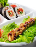 Japanese Cuisine - Yakitori Chicken. Yakitori (Grilled) Chicken. Served with Salad Leaf and Sushi Royalty Free Stock Photo