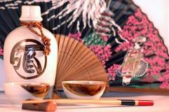 Japanese culture. Fan, sake set and chopsticks Royalty Free Stock Photography