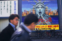 Japanese Culture Shock. An image of the Statue of Liberty in a poster advertising a movie represents the concept of culture shock to an American visiting Tokyo Stock Photo