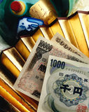 Japanese currency. With Asian objects- pottery and fan Royalty Free Stock Photo