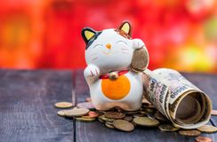 Japanese currency with lucky cat. Japanese currency, Banknotes of Japan, money and finance with lucky cat stock photo