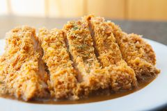 Japanese curry with fried pork cutlet tonkatsu close up Royalty Free Stock Photo