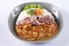 Japanese curry rice with beef isolated on white background Royalty Free Stock Photo