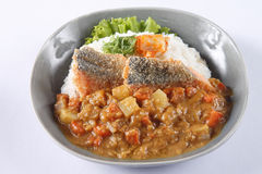 Japanese curry rice with deep fried fish (Sea Bass) isolated on Stock Photography