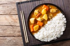 Japanese curry rice with meat, carrot and potato close-up on a p. Late on a table. horizontal top view from above royalty free stock photo