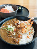 Japanese curry rice with shrimp tempura. On the wood table Stock Images