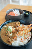 Japanese curry rice with shrimp tempura. On the wood table Stock Image