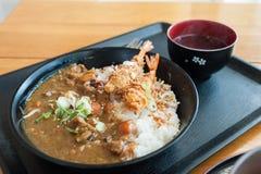 Japanese curry rice with shrimp tempura. On the wood table Royalty Free Stock Photos