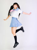 Japanese cute jumping cosplay school girl Royalty Free Stock Photography
