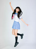 Japanese cute jumping cosplay school girl Stock Photo