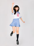 Japanese cute teen school girl. Its a asia/japanese cute teen school girl in pink background Stock Photography