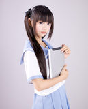 Japanese cute teen school girl. Its a asia/japanese cute teen school girl in pink background stock images