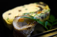 Japanese Cutlass Fish Roll with Burdock. With prawn omelette in the background Royalty Free Stock Photography
