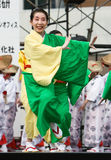 Japanese Daihanya Festival dancer. Kagoshima City, Japan, April 27, 2008. Dancers in green and yellow yukata kimono performing onstage in the Daihanya Festival royalty free stock images
