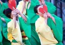Japanese Daihanya Festival Dancers. Kagoshima City, Japan, April 26, 2008. Dancers in green and yellow yukata kimono performing in the Daihanya Festival held in stock images