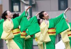 Japanese Daihanya Festival dancers. Kagoshima City, Japan, April 26, 2009. Dancers in green and yellow yukata kimono performing onstage in the Daihanya Festival royalty free stock photo