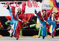 Japanese Daihanya Festival Dancers. Kagoshima City, Japan, April 26, 2009. Dancers in red and blue costumes performing onstage in the Daihanya Festival held in stock photo