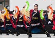 Japanese Daihanya Festival Dancers. Kagoshima City, Japan, April 26, 2009. Dancers in black costumes and holding fans performing onstage in the Daihanya Festival stock image