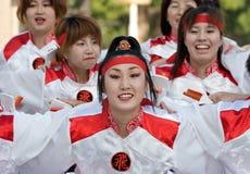 Japanese Daihanya Festival dancers. Kagoshima City, Japan, May 5, 2007. Dancers in white and red yukata kimono performing onstage in the Daihanya Festival held stock photography