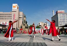 Japanese Daihanya Festival Dancers. Kagoshima City, Japan, May 3, 2007. Young dancers in red perform in in front of the central train station, Chuo Eki at the stock photography