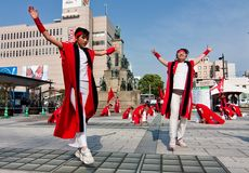 Japanese Daihanya Festival dancers. Kagoshima City, Japan, May 3, 2007. Young dancers in white and red costume performing in the Daihanya Festival held in royalty free stock photography