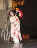 Japanese Dancer with Fan at the Festival of the Orient in Rome Italy. The Festival of the Orient was held at the Exhibition Centre near Rome Airport at Fumincino Stock Photography