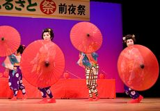 Japanese dancers with umbrellas. Kagoshima City, Japan, October 27, 2007. Japanese dancers in traditional costume perform with umbrellas onstage in the night stock photography