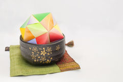 Japanese Decoration. Japanese style paper decoration with clay bowl royalty free stock images
