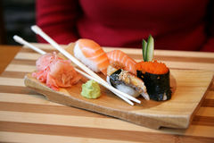 Japanese delicacies. Plate with the Japanese delicacies and seasonings Stock Image