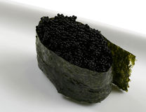 Japanese delicacy food! Black caviar roll. On a dish Royalty Free Stock Image