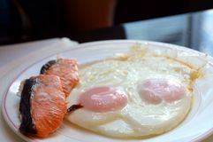 Japanese delicious meal on a plate. Fried eggs and salmon on a white plate Gluten free. Stock Image