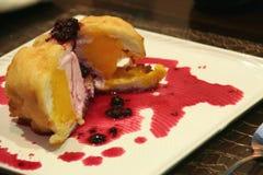 Japanese Dessert. Oriental Ice cream Dessert with berry souce Royalty Free Stock Photos