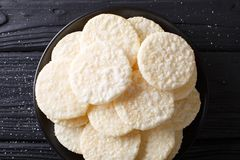 Japanese dessert rice cakes with sugar close-up on a plate. hori. Japanese dessert rice cakes with sugar close-up on a plate on a table. horizontal top view from Stock Images