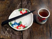 Japanese dinner set with hand painted tea cup, plate and chopsticks. royalty free stock photos