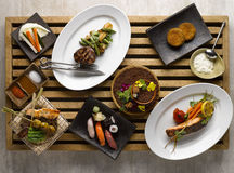 Japanese dinner set mezza with sushi, roasted beef, snapper, veg Stock Image