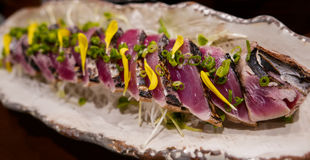 Japanese dish, raw tuna slices gently grilled. An exquisite Japanese dish in a Kyoto restaurant. Raw tuna slices gently grill on the outer coat for a special Stock Photo