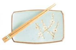 Japanese Dishes. Japanese dish set and chopsticks Stock Images