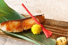 Japanese dishes - Grilled Black Cod. Grilled Black Cod Marinated with Saikyo Miso Paste served on gold plate Royalty Free Stock Photography