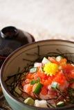 Japanese dishes - sashimi rice set. A set of nice presentation sashimi rice dish - tuna, salmon, yellow tail, sword fish, salmon roe with wasabi and cucumber Stock Photos