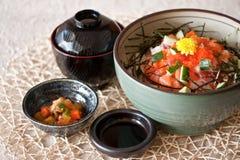 Japanese dishes - sashimi rice set. A set of nice presentation sashimi rice dish - tuna, salmon, yellow tail, sword fish, salmon roe with wasabi and cucumber Royalty Free Stock Photography