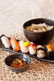 Japanese dishes - sushi & noodle dinning set. A set of nice presentation sushi dish - salmon, yellow tail, sword fish, sweet shrimp, sea urchin, abalone and Stock Photography