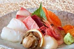 Japanese dishes - sushi & noodle dinning set. A set of nice presentation sushi dish - salmon, yellow tail, sword fish, beef, sweet shrimp, sea urchin, abalone Stock Images