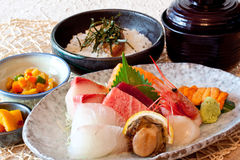 Japanese dishes - sushi & noodle dinning set. A set of nice presentation sushi dish - salmon, yellow tail, sword fish, sweet shrimp, sea urchin, abalone and Stock Photos