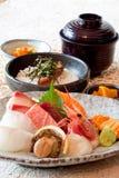 Japanese dishes - sushi & noodle dinning set. A set of nice presentation sushi dish - salmon, yellow tail, sword fish, sweet shrimp, sea urchin, abalone and Royalty Free Stock Photo