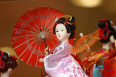 Japanese Doll. Japanese Geisha Doll in Kimoono with fan stock photography