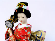 Japanese doll. Traditional Japanese doll in kimono Royalty Free Stock Photo