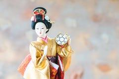 Japanese Doll. On blur background stock image